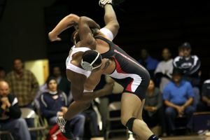 Wrestler lifting another wrestler