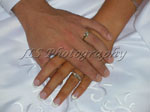 Closeup of wedding rings on bride and groom